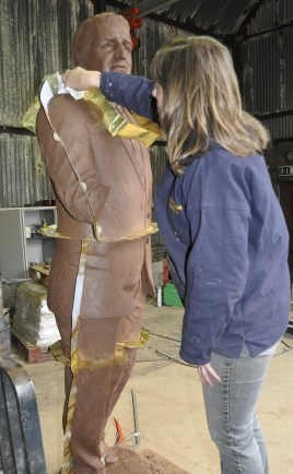 Claire McKenna mouldmaking the Jock Stein memorial bronze statue cast at his a4a art for architecture studio bronze foundry, Ayrshire, Scotland