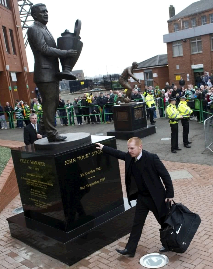 Neil Lennon Celtic football manager touch the bronze statue of Jock Stein, created by John McKenna A4A art for architecture sculpture foundry, Ayrshire, Scotland