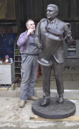 John McKenna applying patina to the Jock Stein memorial bronze statue cast at his a4a art for architecture studio bronze foundry, Ayrshire, Scotland