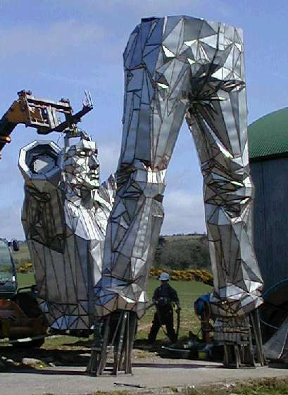 colossal public art mining sculpture torso
